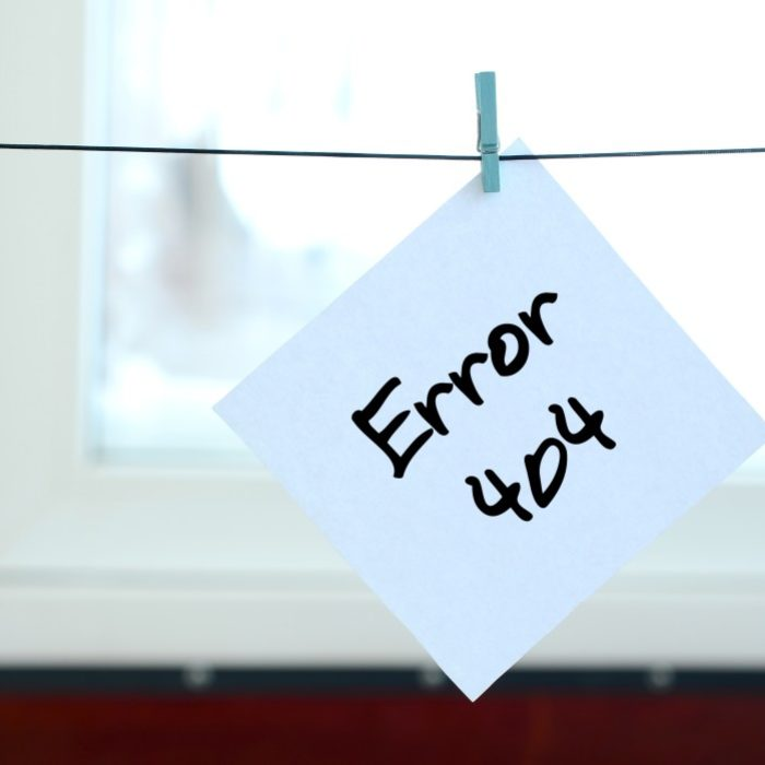 error-404-note-is-written-on-a-white-sticker-that-hangs-with-a-clothespin-on-a-rope-on-a-background_t20_Nxox2N